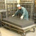 Sheets of wire grid panels in production.  From here, they can be formed, powder coated or shipped as is.