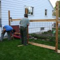 Wire grid fence panels - a weekend project for a homeowner.  It helps to have a few handy friends.